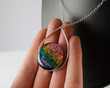Load image into Gallery viewer, handmade metalsmithed necklace made from strips of recycled circuit board that were arranged into a rainbow.