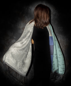 This elegant shawl has two different images. One side has Chrysanthemum pattern and the other side has ginkgo leaves pattern.  It was woven with fine merino wool and silk so it takes a long time to finish this particular shawls. This luxurious shawl will make you feel like the star of the show.