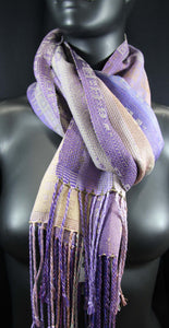 Purples and Beige in this gorgeously rich scarf is hand-woven at the Bettlehouse