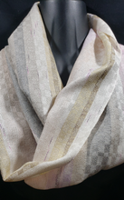Load image into Gallery viewer, This amazingly soft and luxurious scarf is charming, traditional and romantic. It will help bring out the stylish charm of any piece from your wardrobe.  Handwoven with silver and gold color silk yarns.