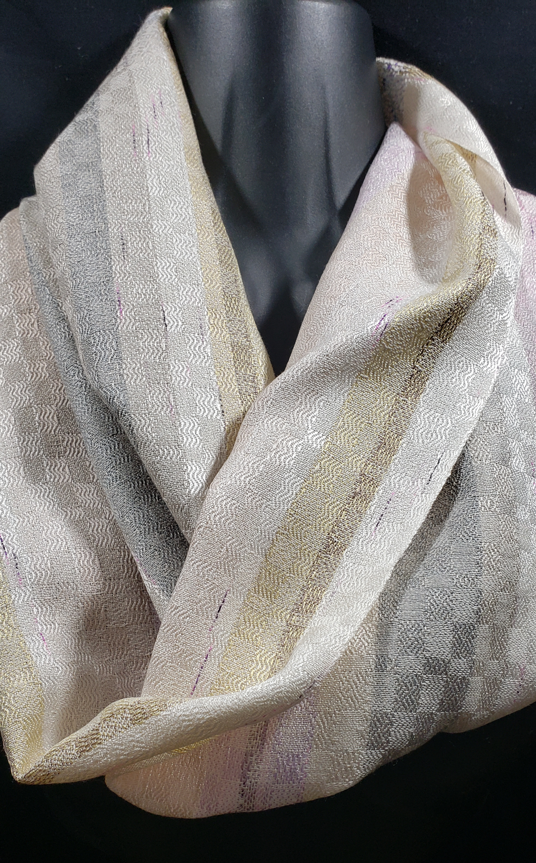 This amazingly soft and luxurious scarf is charming, traditional and romantic. It will help bring out the stylish charm of any piece from your wardrobe.  Handwoven with silver and gold color silk yarns.
