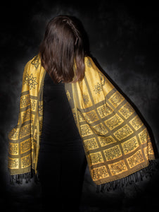 This one of a kind shawl is woven with silk and cotton.  A light weight, elegant shawl for any special occasions. yellow and black