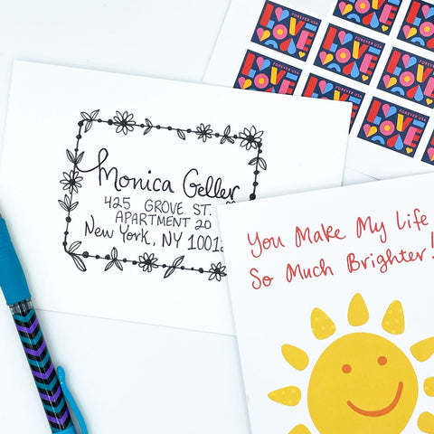 Drawn Ink Floral Rectangle Border Around Address on White Envelope with Love Postage Stamps and Yellow Smiling Sun Greeting Card by Sunny Day Designs - Snail Mail Fun Blog Post