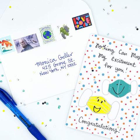 White Envelope with 5 Fun and Colorful Postage Stamps, confetti, a blue pen, and the COVID Congrats celebration greeting card by Sunny Day Designs - Snail Mail Fun Blog Post