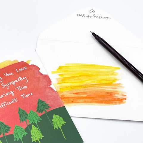 Painted Yellow and Orange Watercolor Area on White Envelope next to Sympathy Sunset Watercolor Greeting Card by Sunny Day Designs - Snail Mail Fun Blog Post