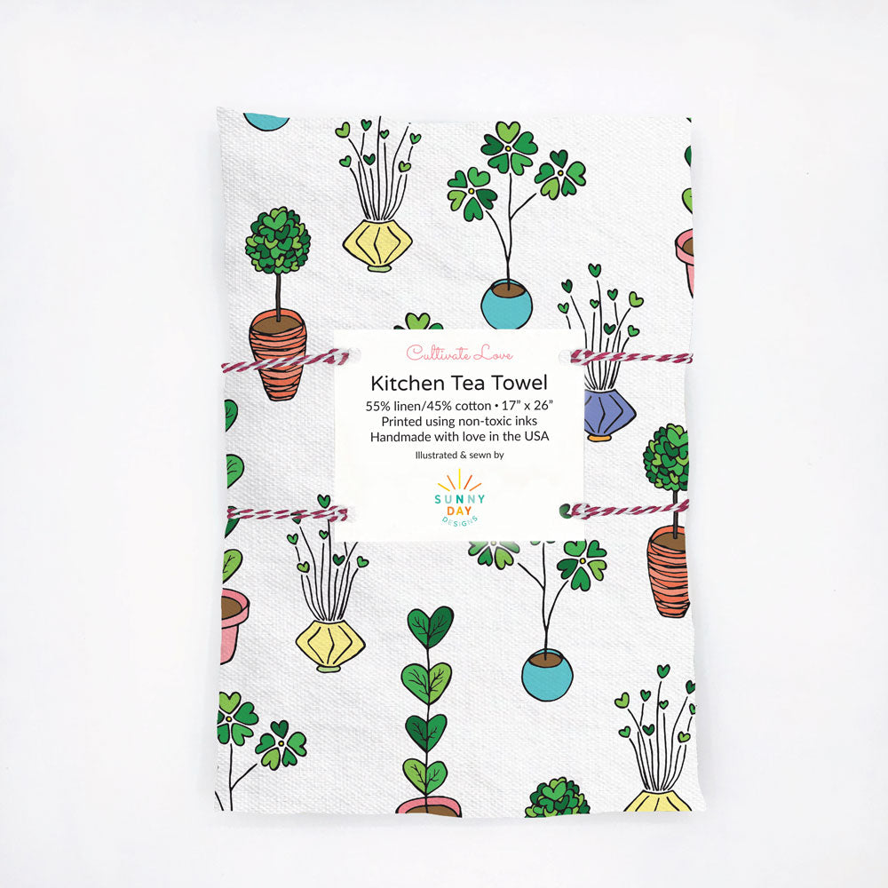 Whimsical, heart-shaped, potted plants adorn this contemporary printed  kitchen tea towel. Perfect for Valentine's Day! Designed and handmade in the USA from durable and soft linen/cotton fabric.