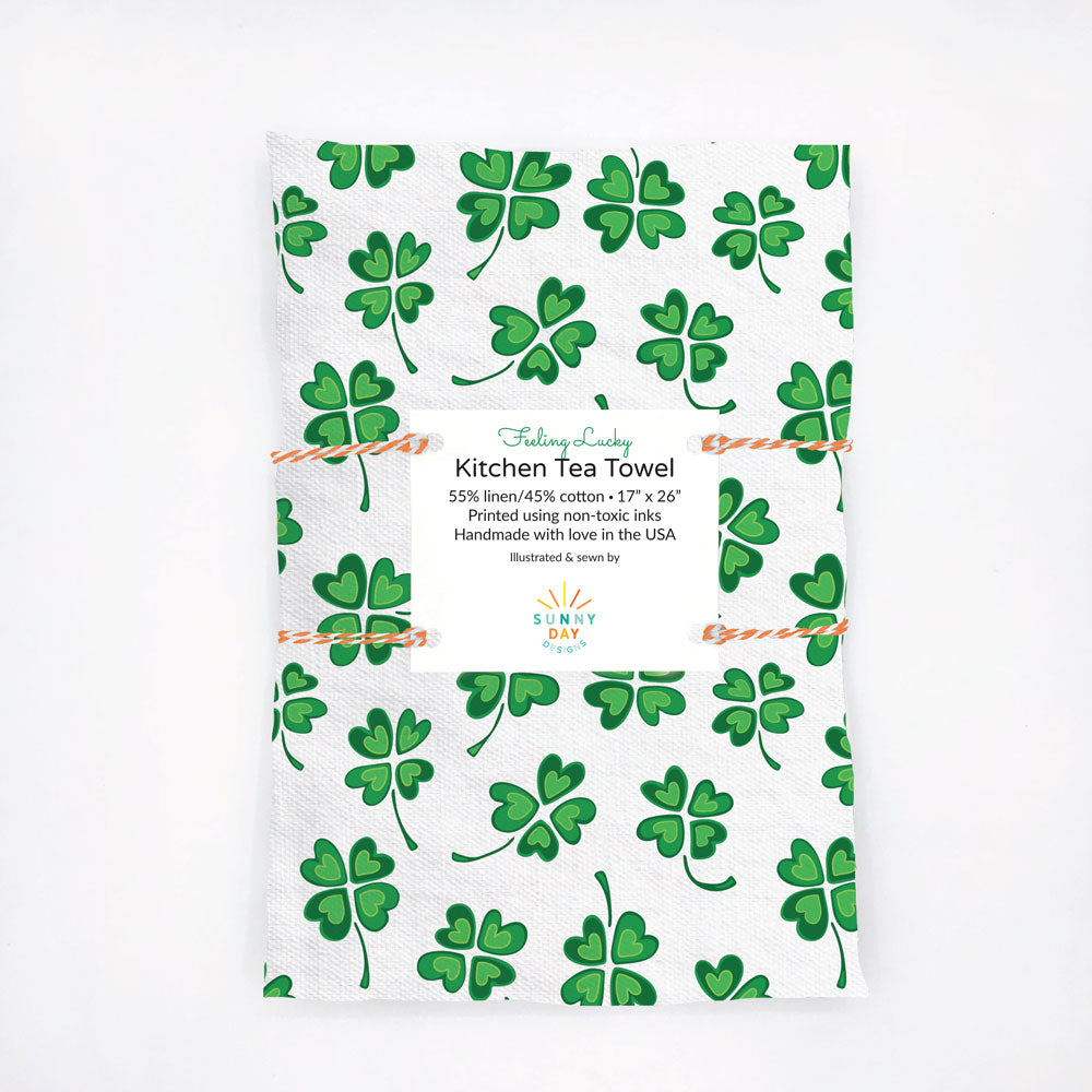 Green and white, Irish-themed, four-leaf clover patterned kitchen tea towel. Perfect for St. Patrick's Day! Designed and handmade in the USA from durable and soft  linen/cotton fabric.