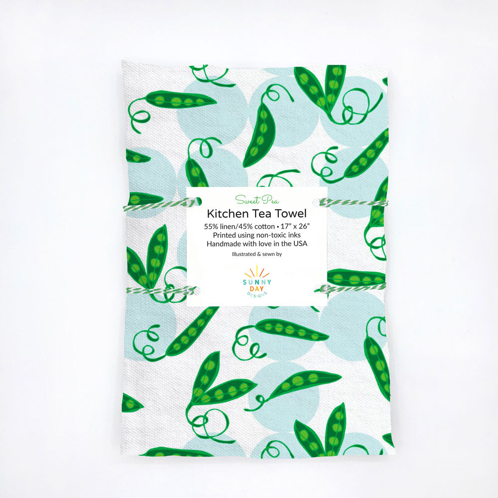 Green, light blue, and white, sweet pea pod-themed kitchen tea towel. This eco-friendly dish towel makes a great  kitchen gift for gardeners and vegetarians! Designed and handmade in the USA from durable and soft linen/cotton fabric.