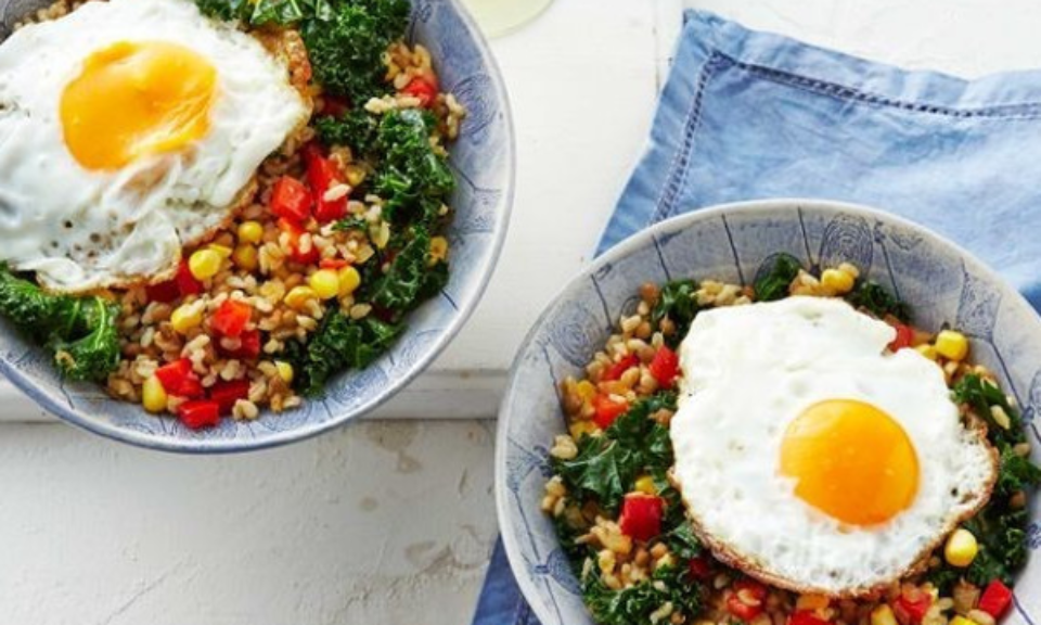 Kale, green lentils and rice bowl topped with fried egg