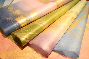 Colored Paper with Gold Brush Strokes