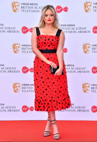 Emily Atack wearing  Natalie & Alanna for the Television Baftas red carpet event