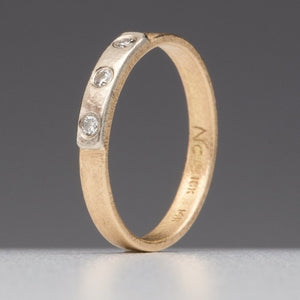 Modern Simplicity: Three-Diamond Yellow Gold Ring