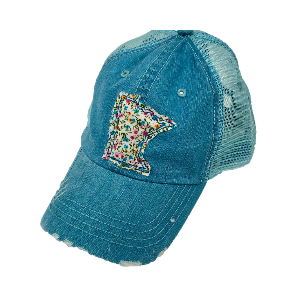 light blue minnesota hat with flowers on the state