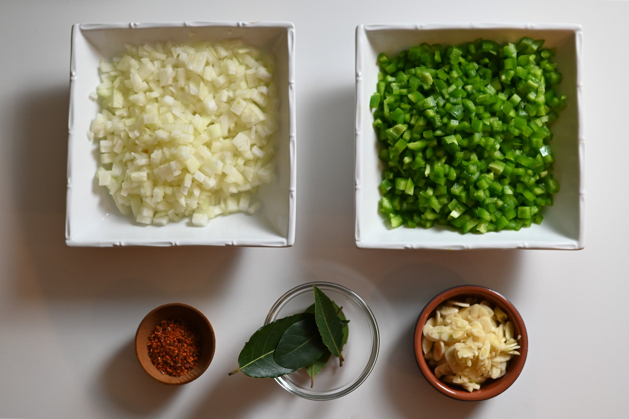 cioppino mise en place diced onion peppers chili flakes garlic bay leaf