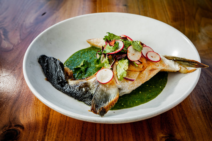 Broiled Yellowtail Collar plated with colorful salad