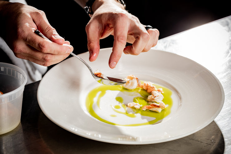 Chef hands plating dish