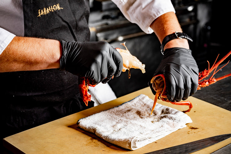 Chef hands twisting spiny lobster