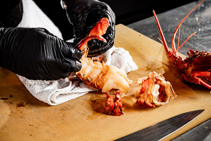 Chef hands removing spiny lobster shell