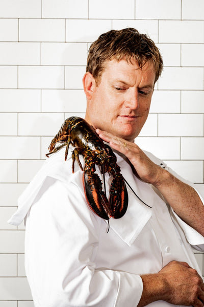 chef petting lobster on his shoulder