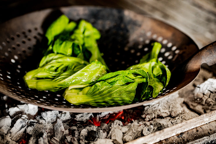 bok choy cooking over charcoal
