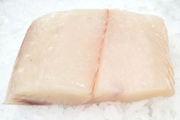 alaskan halibut fillet on ice