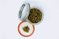 green peppercorn in a mason jar