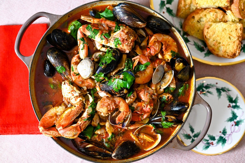 cioppino on the table with garlic bread