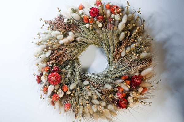 red and green dried floral wreath