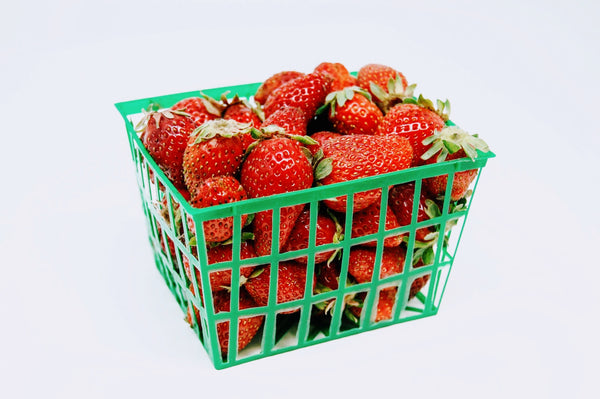 red strawberries in a green basket
