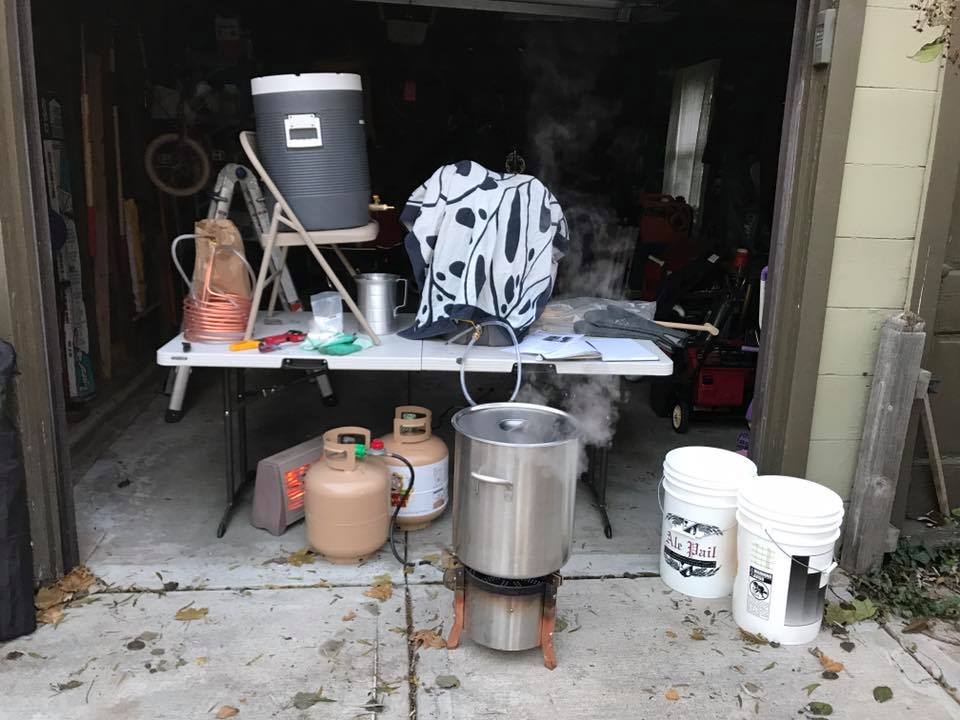 Traditional Homebrewing Setup. Burner, Kettle, Coolers, Buckets, Propane Bottles, Heater, Towels, Table