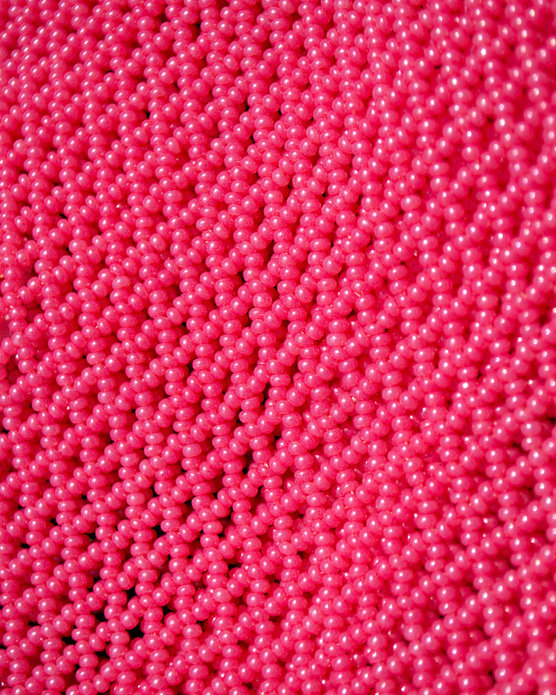 closeup picture of pink beads as they are in all Marmaclub Fringe Hot Pink bags