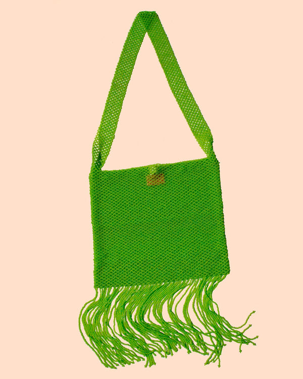 A product picture of the Marmaclub Crossover Fringe bag in color Lime Green (light green)