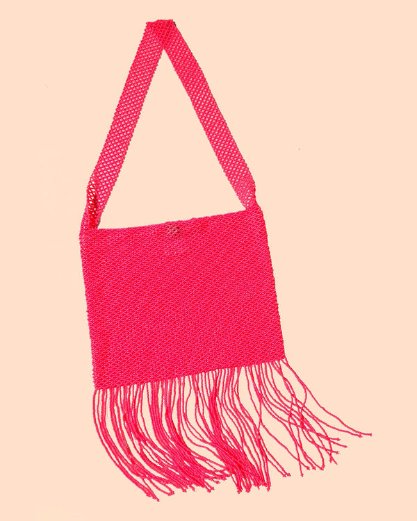 A product picture of the Marmaclub Crossover Fringe bag in color Hot Pink (medium dark pink))