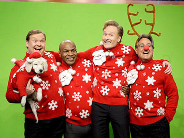 Andy Richter, Mike Tyson, Conan O'Brien and Max Weinberg in Christmas sweaters.
