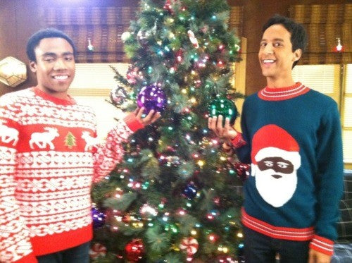Donald Glover and Danny Pudi in Christmas sweaters.