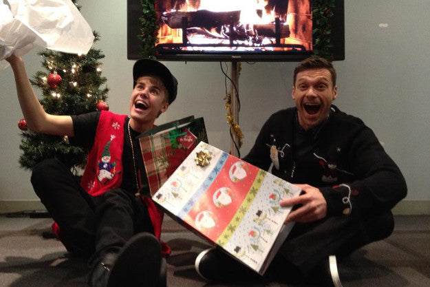 Justin Beiber and Ryan Seacrest in Christmas sweaters
