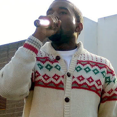 Kanye West in a Christmas sweater
