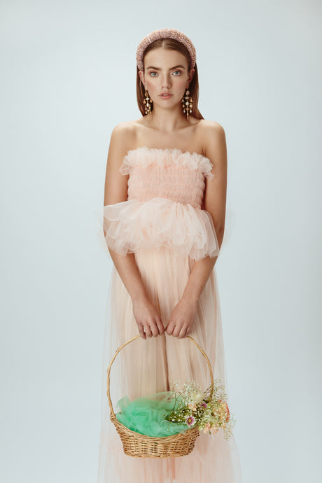 Model wearing blush pink tulle top
