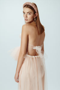 Model wearing blush pink tulle top back view