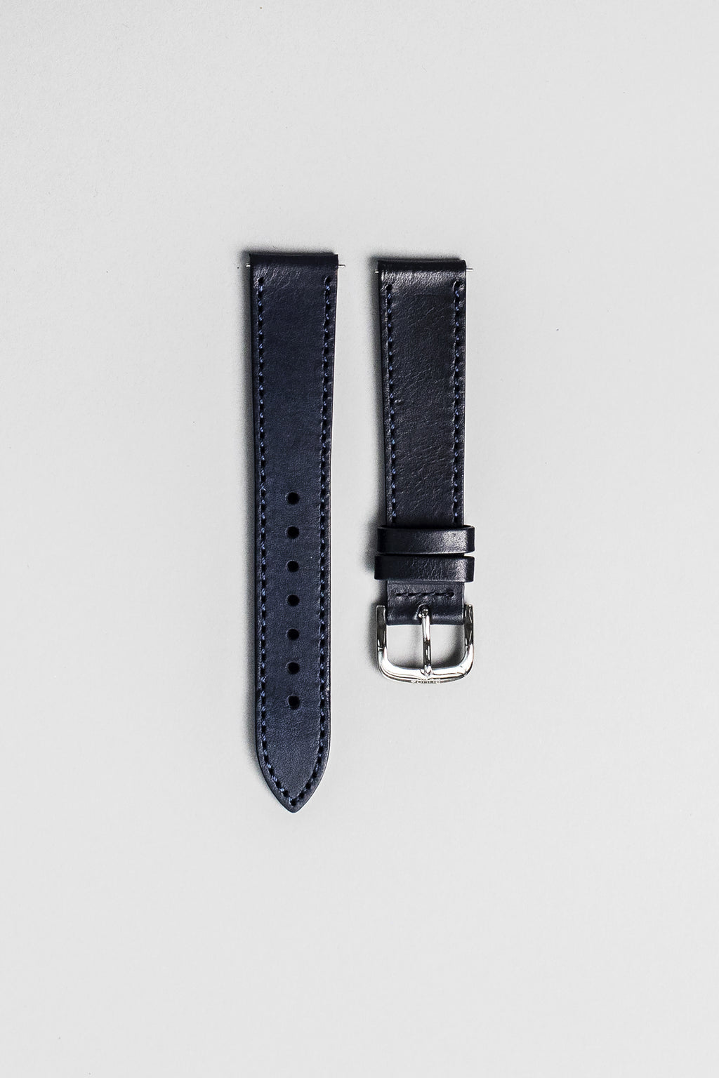 The blue veg tan Italian leather strap with polished buckle. 18mm
