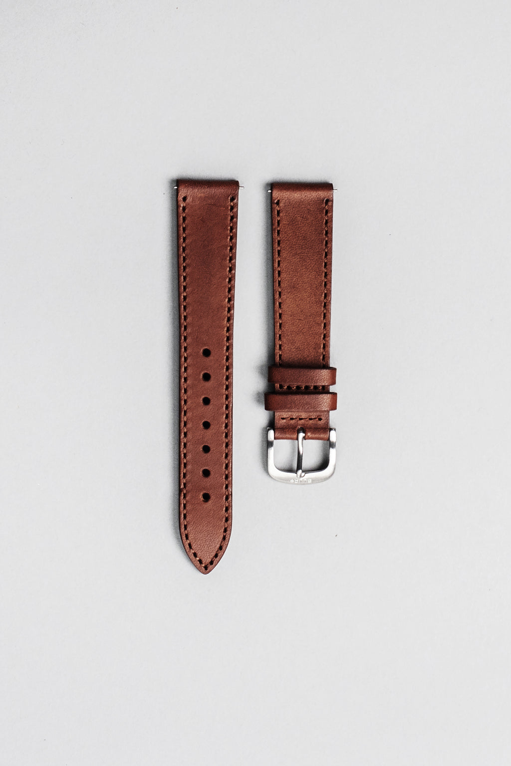 The brown Italian veg tan leather strap with brushed buckle. 18mm