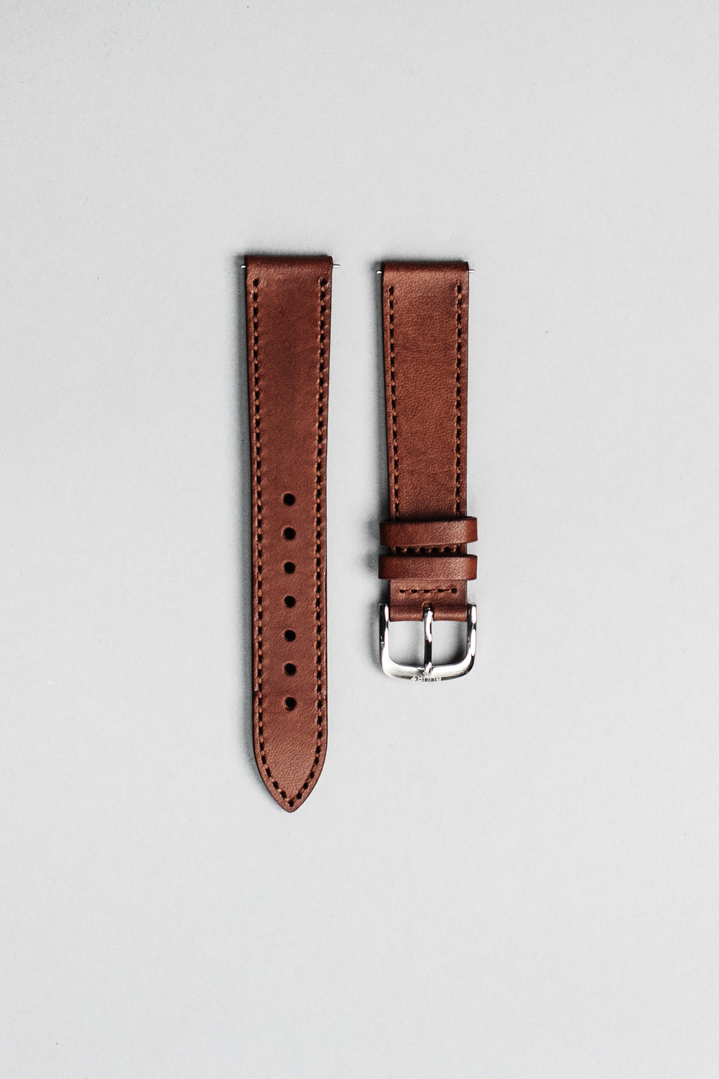 The brown Italian veg tan leather strap with polished buckle. 18mm