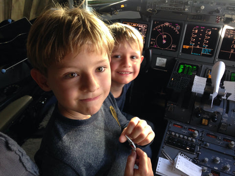 Traveling with children, boys in the cockpit