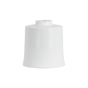 white cylindrical ceramic vase
