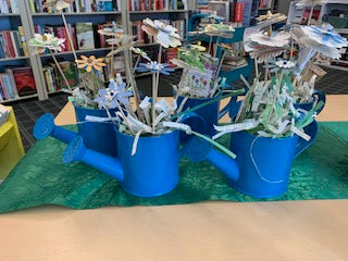 Watering can with paper flowers & seeds