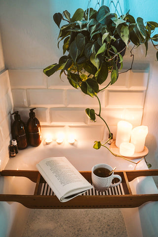 candles, book, tea, in a bath setting