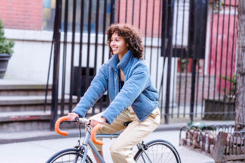 Woman riding her bike in the fall