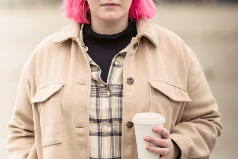 Woman with pink hair wearing shearling shacket
