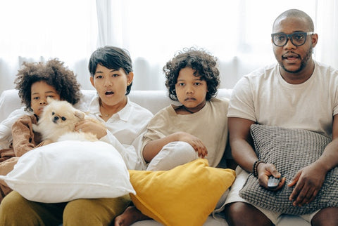 Family of 4 watching a movie