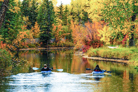 Couple kayaking in the fall